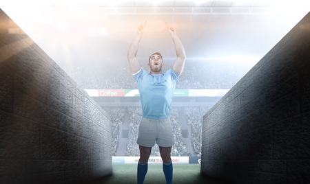 rugby player: Rugby player cheering and pointing against rugby stadium Stock Photo