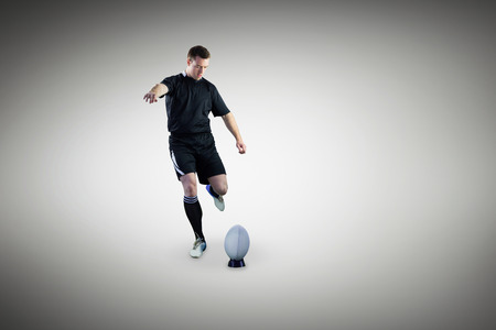 scoring: A rugby player scoring a try against grey vignette