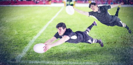 scoring: A rugby player scoring a try against pitch