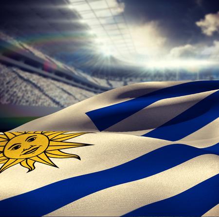 soccer: Waving Uruguayan flag against rugby stadium