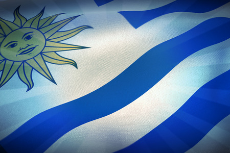 cropped: Cropped flag of Uruguay against blue background Stock Photo