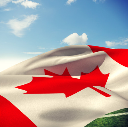 canadian flag: Low angle view of Canadian flag against sky with clouds