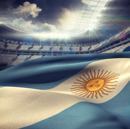 argentina flag: Argentina flag waving in wind against rugby stadium