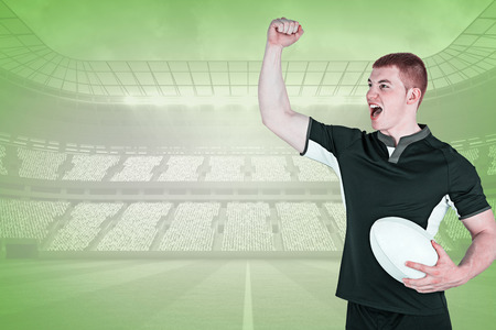 winning pitch: A rugby player gesturing victory against green vignette