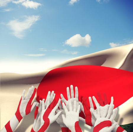 raise the white flag: People raising hands in the air against blue sky with clouds