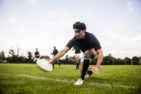 world sport event: Rugby players training on pitch at the park