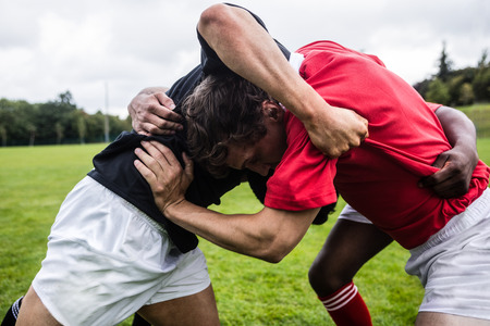 clash: Rugby players doing a scrum at the park