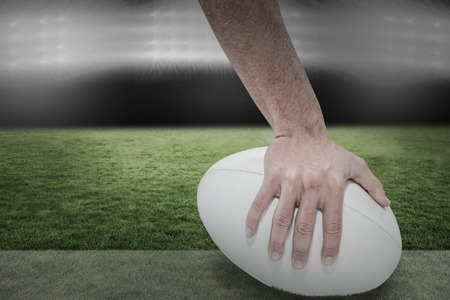 player: Close-up of sports player holding ball against spotlight