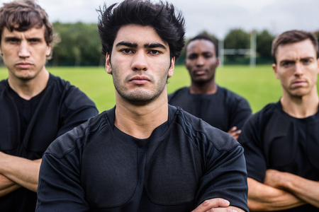 scowling: Rugby players scowling at camera at the park