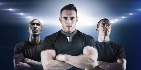 rugby player: Tough rugby player looking at camera against spotlights