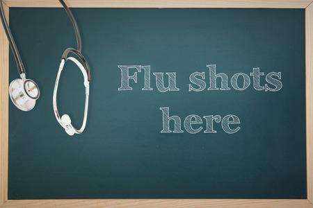 flu shots: flu shots against stethoscope Stock Photo