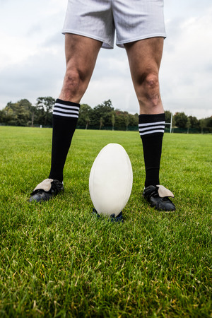 kick ball: Rugby player about to kick ball at the park Stock Photo