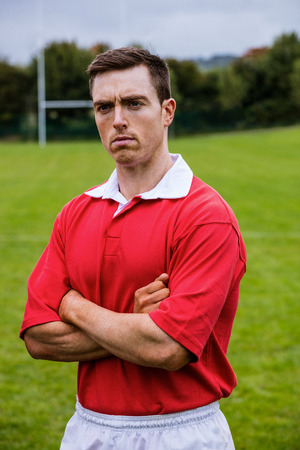 tough: Tough rugby player ready to play at the park Stock Photo