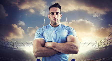 rugby: Rugby player looking at camera against rugby stadium