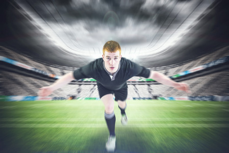 opponent: Rugby player tackling the opponent against rugby stadium Stock Photo