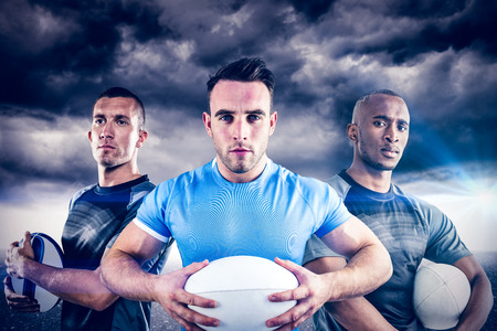 stormy sky: Tough rugby players against stormy sky