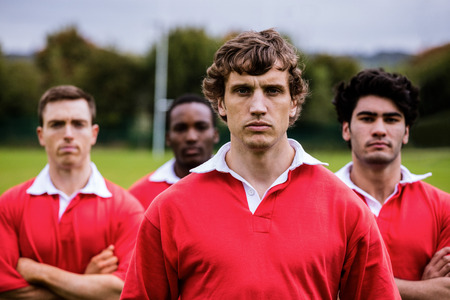 tough: Tough rugby players ready to play at the park Stock Photo