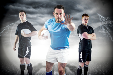 rugby player: Tough rugby players against cloudy sky