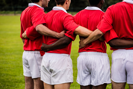 standing together: Rugby players standing together before match at the park