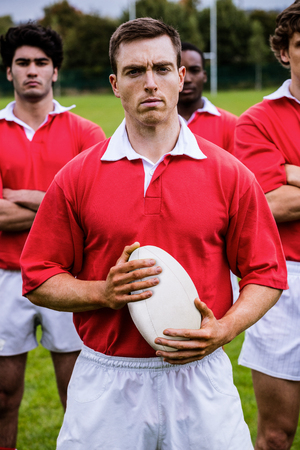 teammates: Tough rugby players ready to play at the park Stock Photo