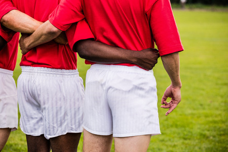 teammates: Rugby players standing together before match at the park