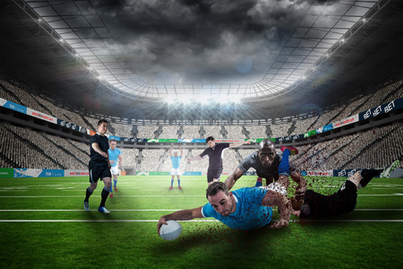 euphoria: Rugby player doing a drop kick against rugby stadium
