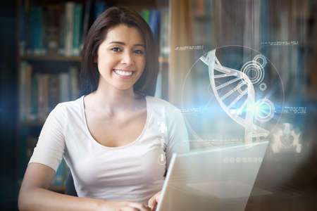 high technology: Illustration of DNA against student with a laptop Stock Photo
