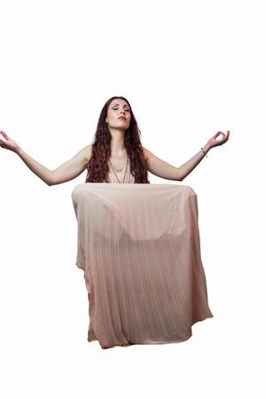 levitating: Portrait of woman levitating with eyes closed against white background