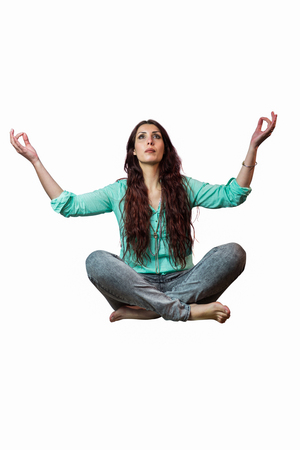 levitating: Full length of woman levitating against white background Stock Photo