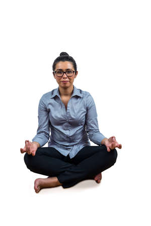 legs crossed: Woman meditating with her legs crossed against a white background Stock Photo