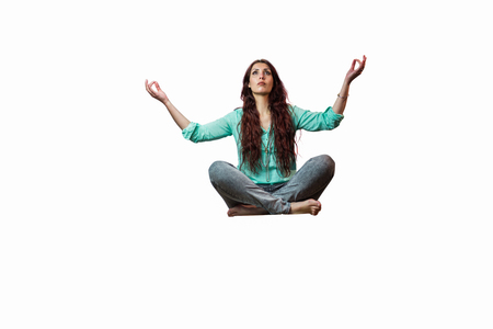 levitating: Full length of woman levitating with arms raised against white background