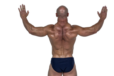 tricep: Rear view of muscular man with arms raised against white background