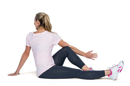 over white background: Sporty woman exercising over white background