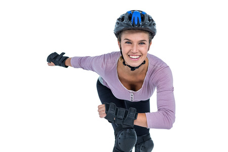 knee bend: Portrait of cheerful young woman skating over white background