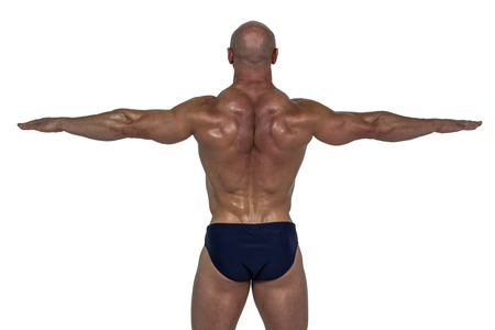 shaved head: Rear view of muscular man exercising with hands against white background Stock Photo