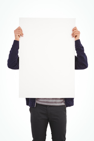 obscured face: Man showing billboard in front of face against white background Stock Photo