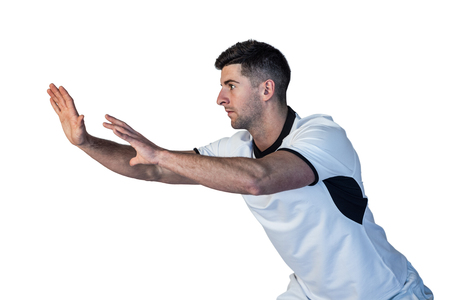 Side view of rugby player positioning over white background Stock Photo