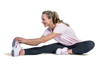 touching toes: Happy sporty woman exercising over white background Stock Photo