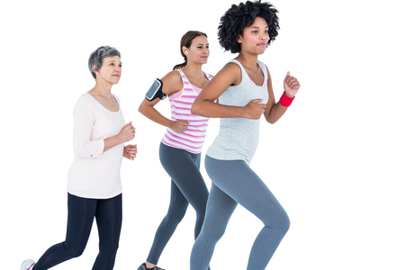 portable mp3 player: Determined female friends jogging against white background