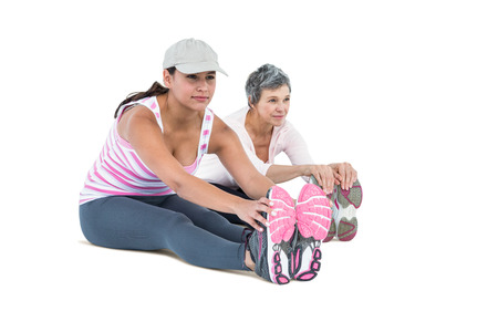 touching toes: Women touching toes while exercising on white backgorund Stock Photo