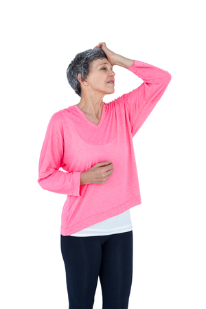Mature woman suffering from headache against white background Stock Photo