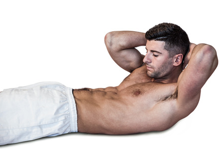 crunches: Man doing abdominal crunches over white background Stock Photo