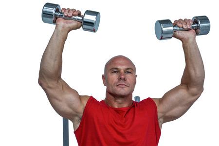 free weight: Athlete lifting dumbbells against white background