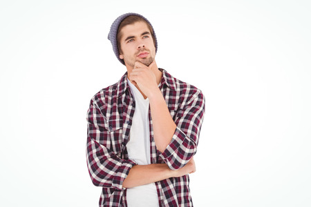 cool guy: Thoughtful hipster with hand on chin standing against white background