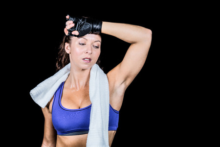 body concern: Tired athlete woman looking down against black background Stock Photo