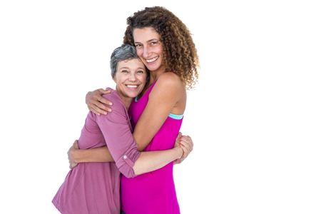 one parent: Portrait of cheerful daughter hugging mother against white background