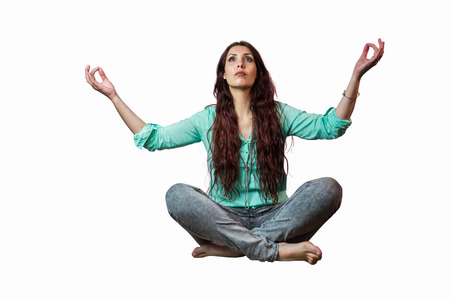 levitating: Full length of beautiful woman levitating against white background Stock Photo