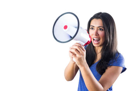 amplified: Woman shouting into a megaphone against a white background Stock Photo