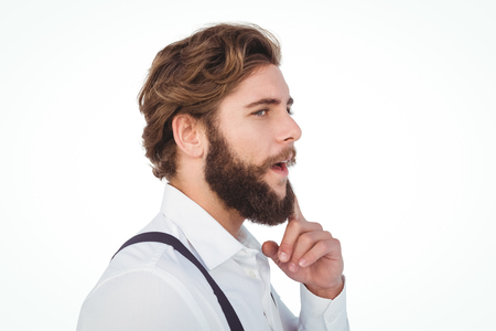 chin: Thoughtful hipster with finger on chin against white background Stock Photo
