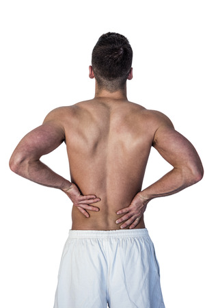 dreariness: Rear view of man suffering from back pain against white background